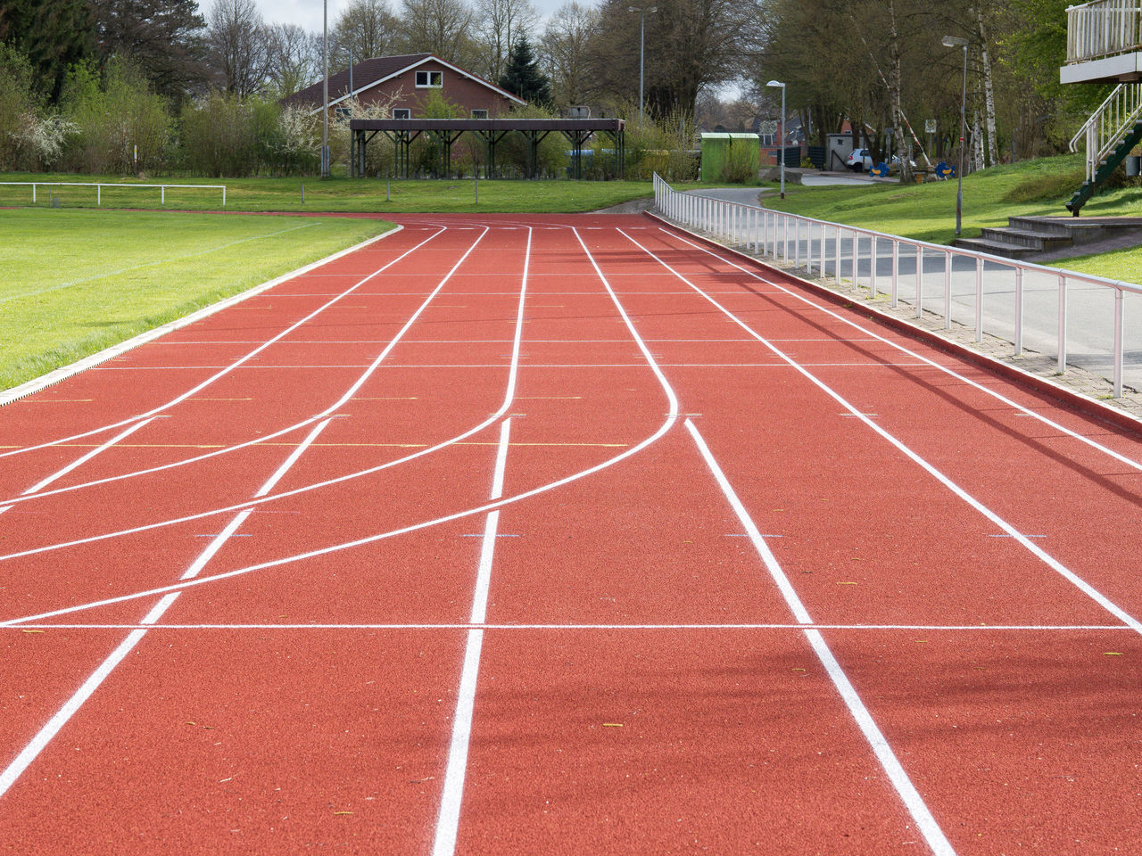 Built Structure Challenge Competition Competitive Sport Day Grass No People Outdoors Running Track Sport Sports Race Sports Track Starting Line Track And Field Tree