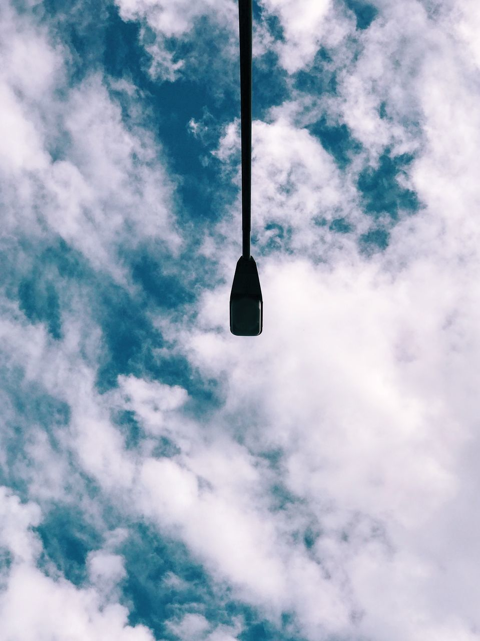 Low Angle View Of Street Light Against Cloudy Sky During Sunny Day