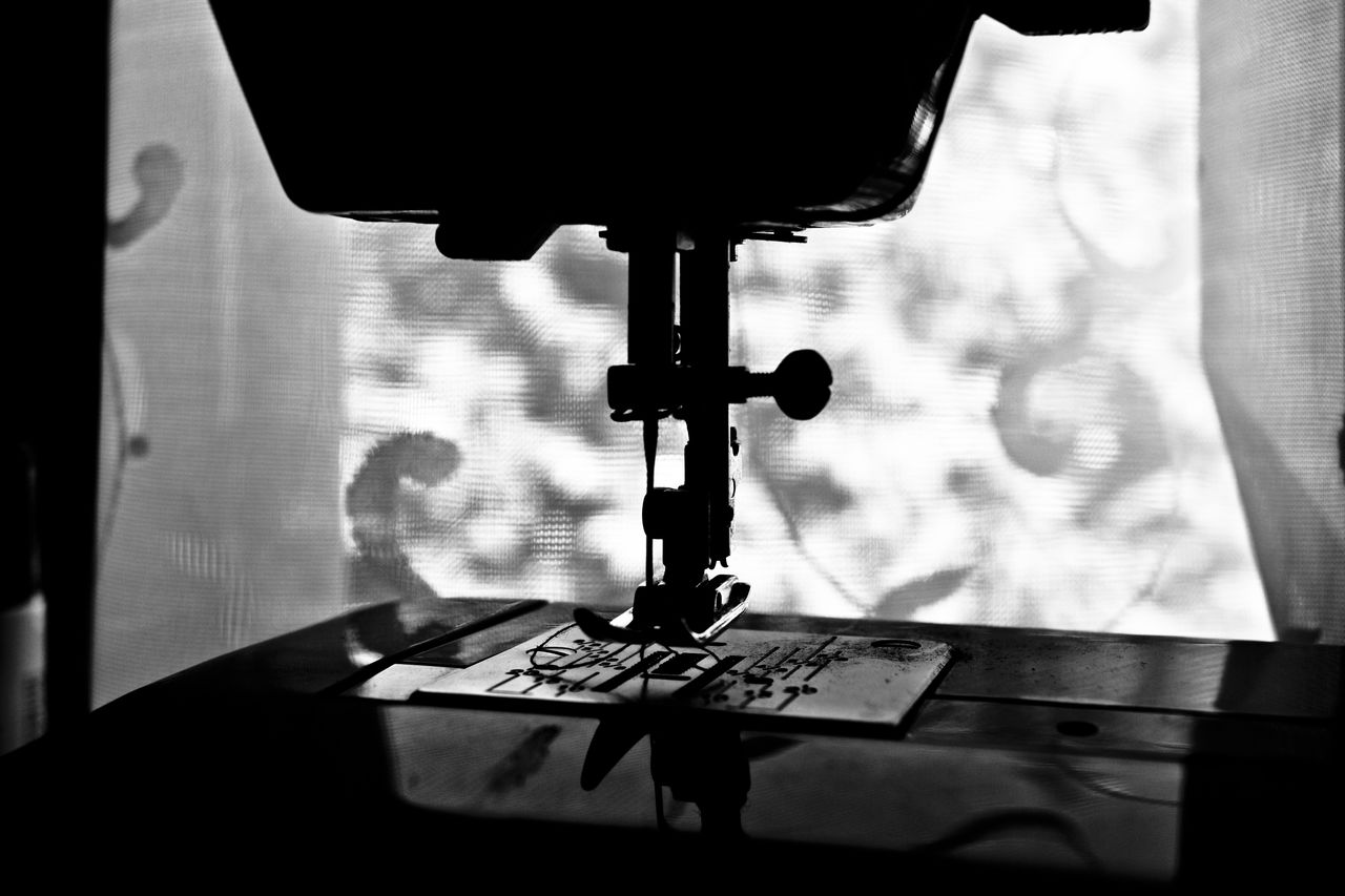 sewing machine, close-up, indoors, textile, manufacturing equipment, no people, technology, day