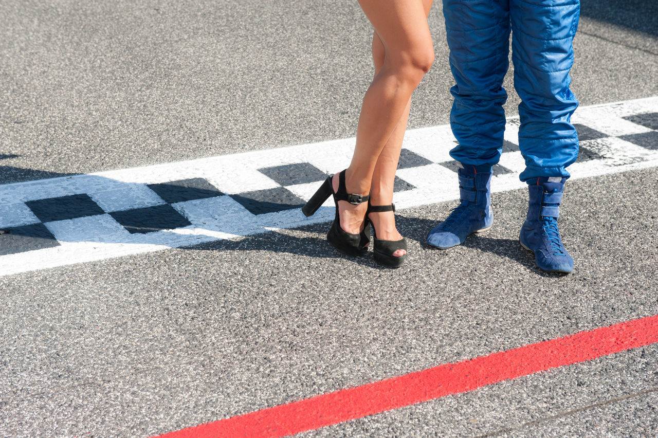 Grid girl and driver on racing track finish line Day Driver Finish Line  Grid Girl Human Foot Legs Low Section Motor Sport Person Road Sexygirl Shadow Standing Track Woman