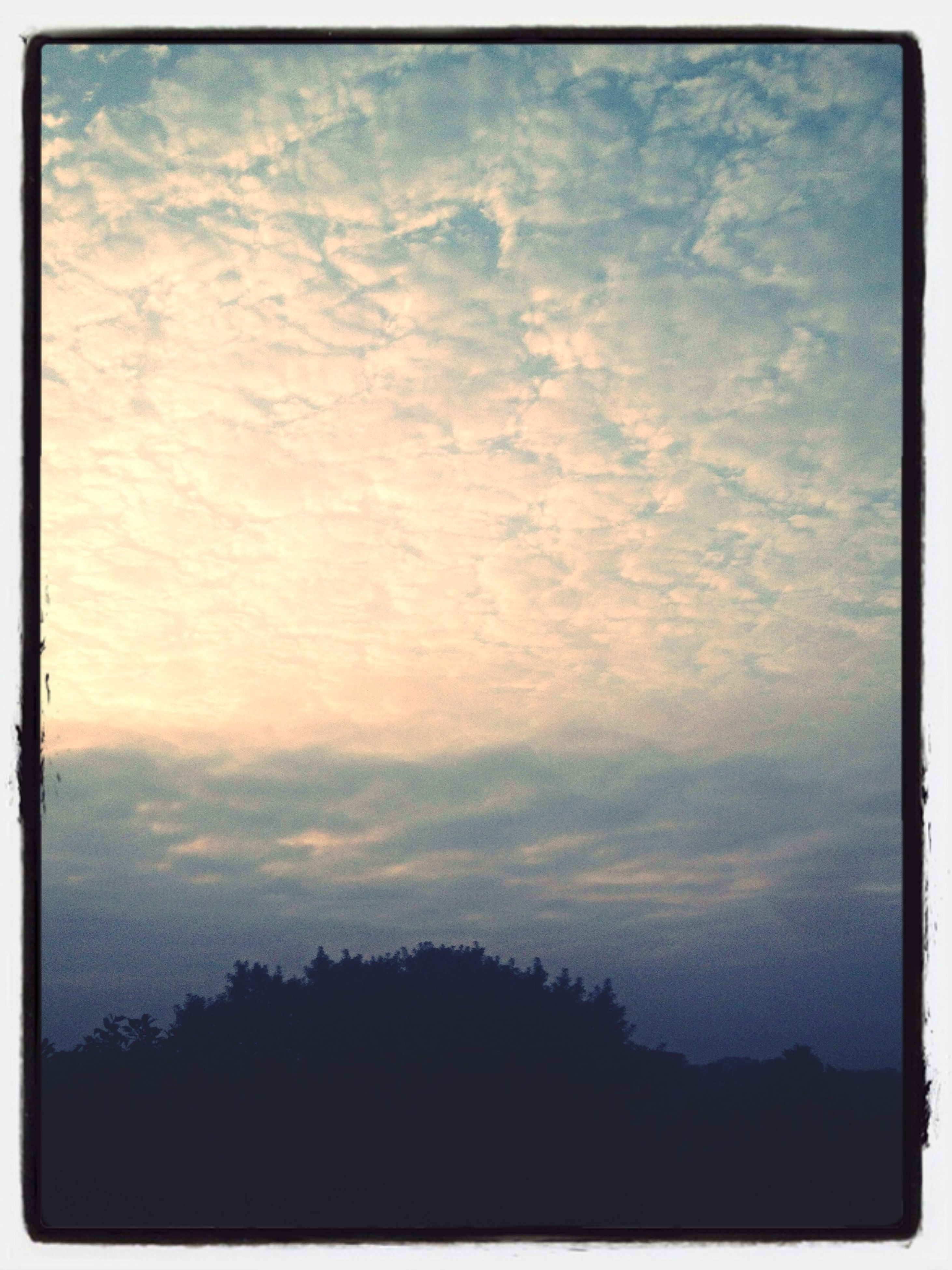 transfer print, sky, silhouette, tranquility, auto post production filter, scenics, beauty in nature, cloud - sky, tranquil scene, tree, low angle view, nature, cloudy, sunset, cloud, idyllic, dusk, outdoors, no people, weather