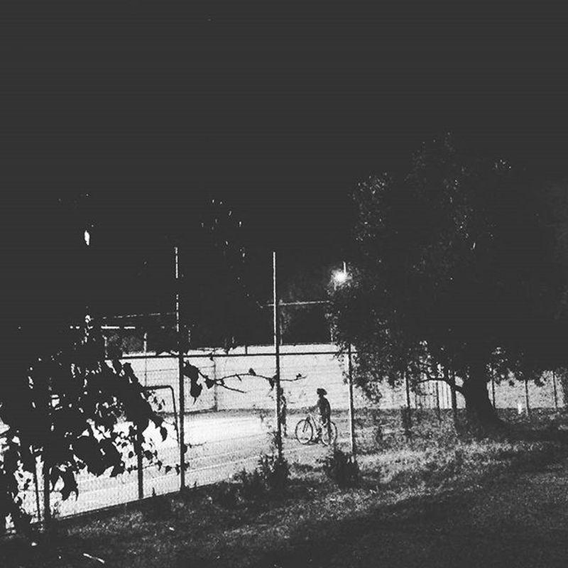 "Whatiseewheniwalk ""Boy on a bike on the tennis court"" Boyhood Photooftheday Zichronyaakov Blackandwhite Instagram Igers Insta_Israel Ig_israel Bnw Bicycle"