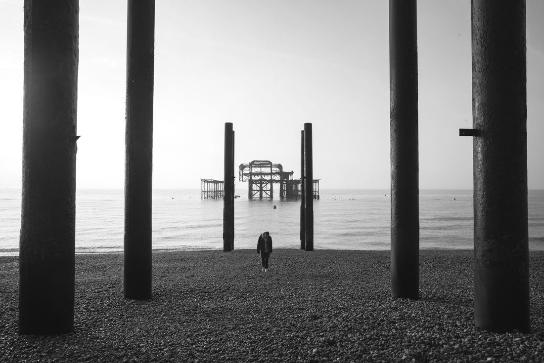 Brighton Beach Sea Horizon Over Water Architectural Column Clear Sky Sand Pebble One Person Outdoors Sky 21mm Water Ocean England Bnw Landscape The Secret Spaces The Secret Spaces Breathing Space
