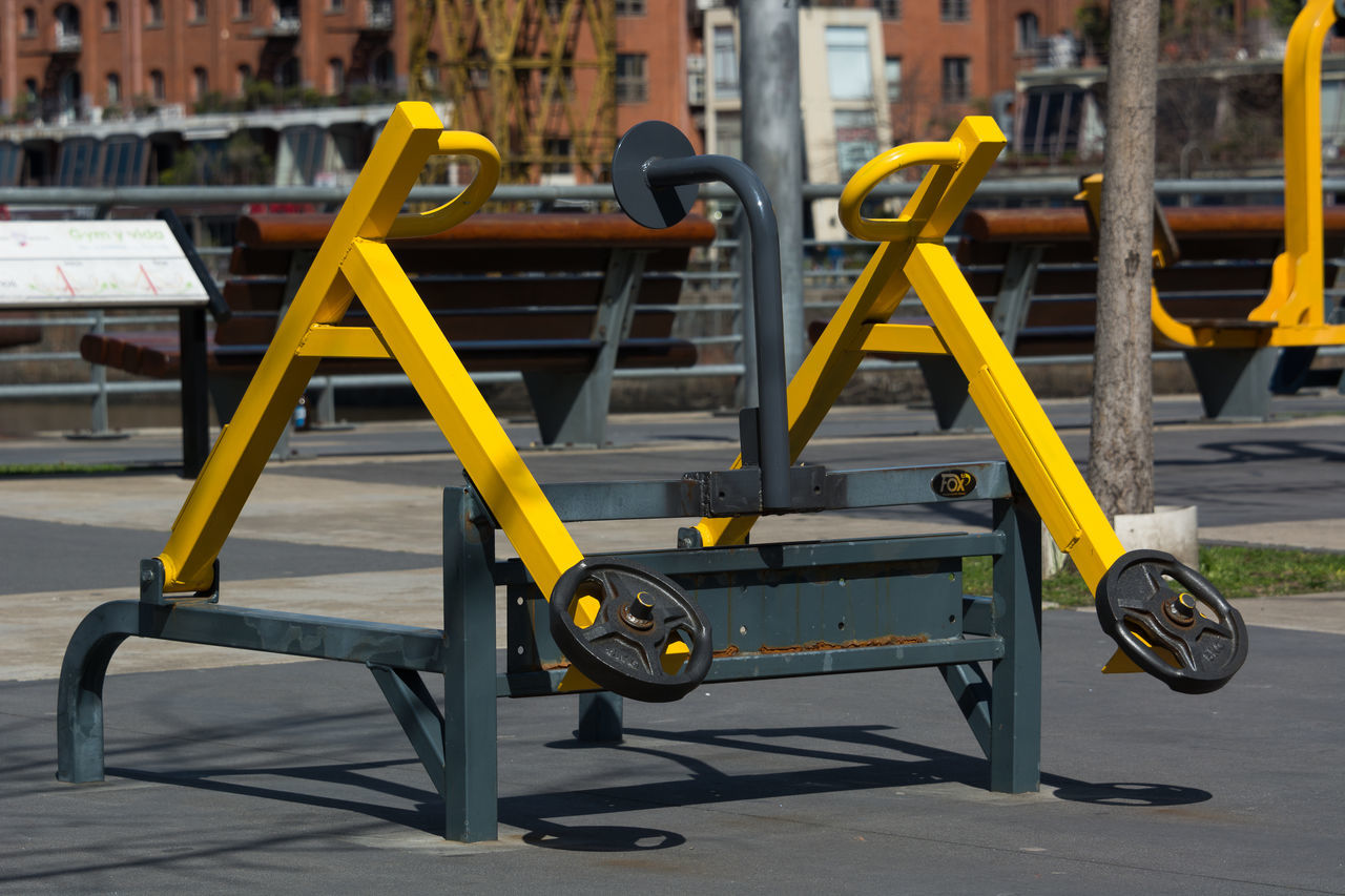 Building Exterior Built Structure City City Street Close-up Day Exercise Equipment No People Outdoors Urban Landscape Urban Lifestyle Urban Living Yellow