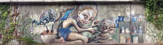 More Graffiti ! ⇢ 'Lily uses her gift to make gifts' by Street Art Duo 'Herakut'.