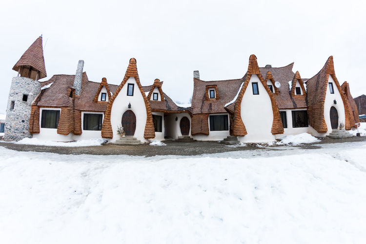 The Valley of the Fairies,Romania - February 2017 Transylvanian Hobbit hotel built out of clay and sand Architecture Architecture_collection Beautiful Clay Castle, The Valley Of The Fairies-Transilvania, Romania, Winter, Day Editorial Use Only Stone Vintage
