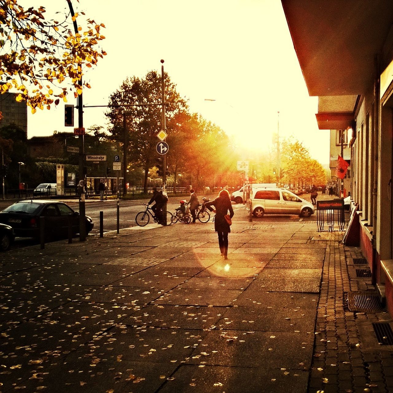 People On Sidewalk By City Street During Sunrise