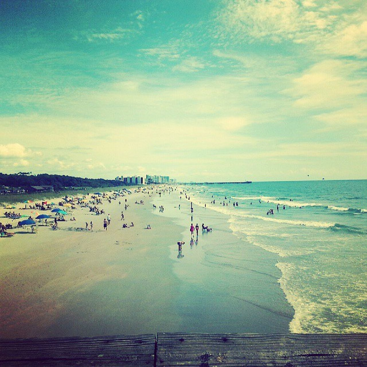 beach, sea, water, vacations, large group of people, nature, sand, beauty in nature, horizon over water, sky, scenics, real people, leisure activity, outdoors, tranquil scene, lifestyles, day, men, enjoyment, tranquility, wave, women, weekend activities, cloud - sky, travel destinations, summer, people, adult