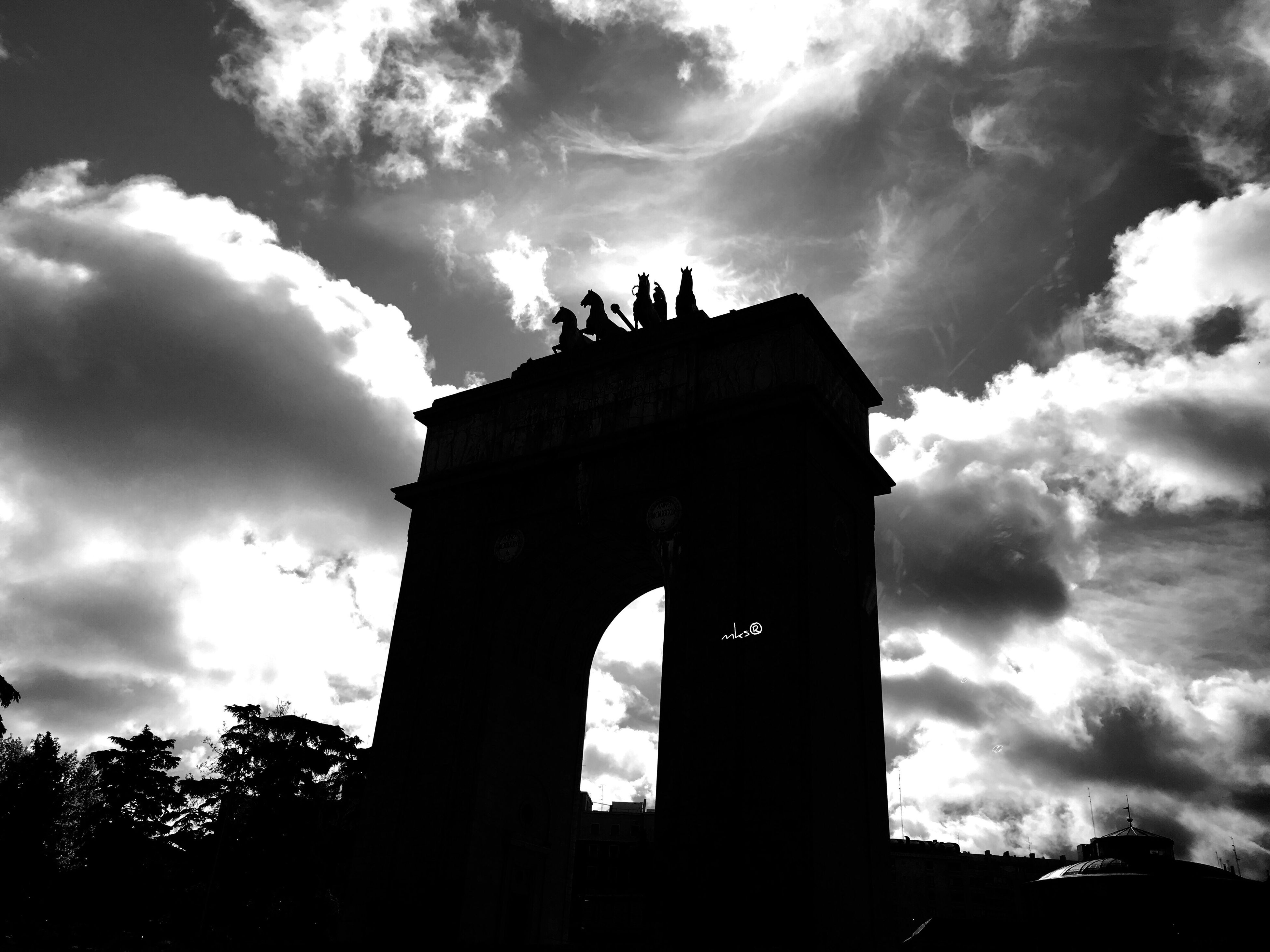 low angle view, sky, architecture, built structure, cloud - sky, silhouette, building exterior, history, cloud, old, cloudy, outdoors, the past, religion, arch, tree, no people, architectural column, dusk