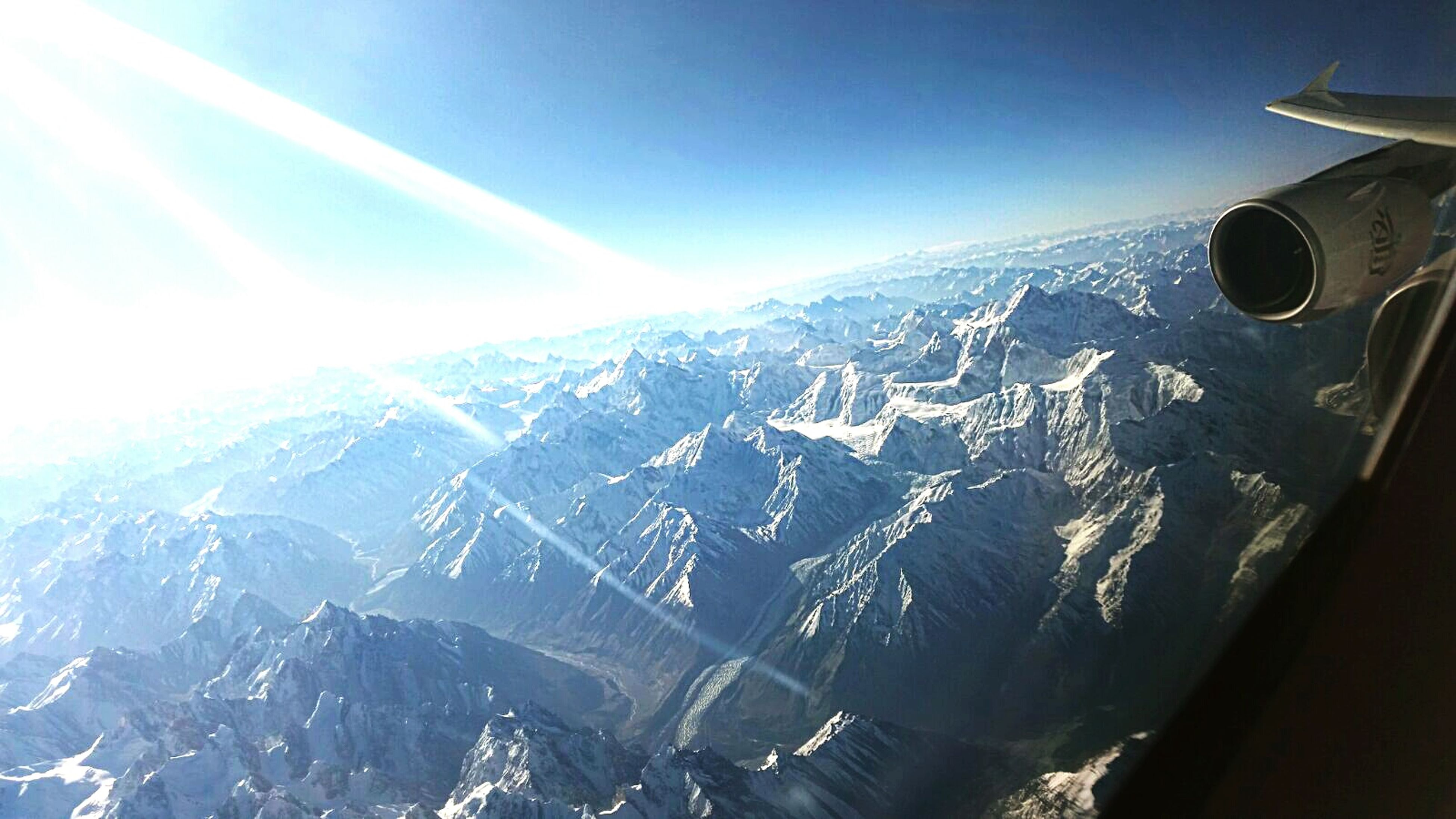 mountain, transportation, air vehicle, mode of transport, airplane, landscape, scenics, mountain range, blue, snow, aircraft wing, beauty in nature, snowcapped mountain, sky, aerial view, flying, travel, part of, nature, cropped