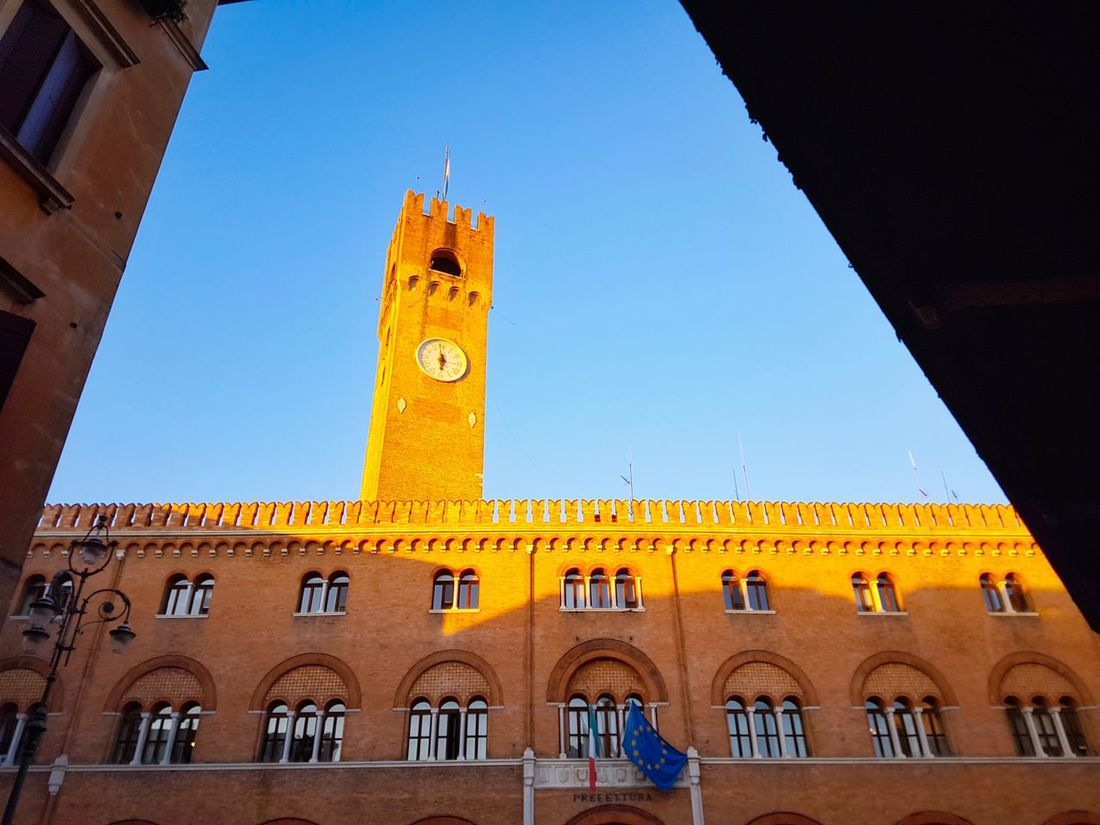 Clock Architecture Clock Tower Building Exterior Built Structure Low Angle View Time Day Outdoors Clock Face Minute Hand Sky Low-angle Shot Merlons Sunset Historical Buildings Cityscape City Travel Destinations Architecture Geometric Lines