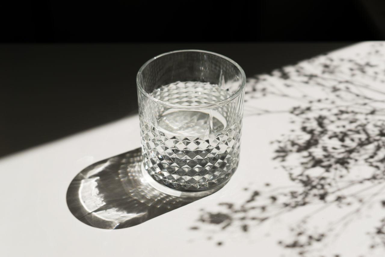 Sunlight Falling On Water Glass