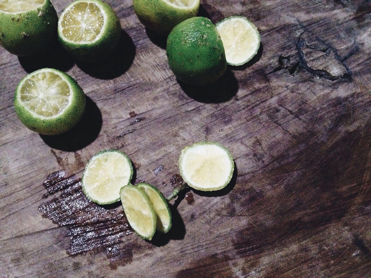 High Angle View Of Limes On Table