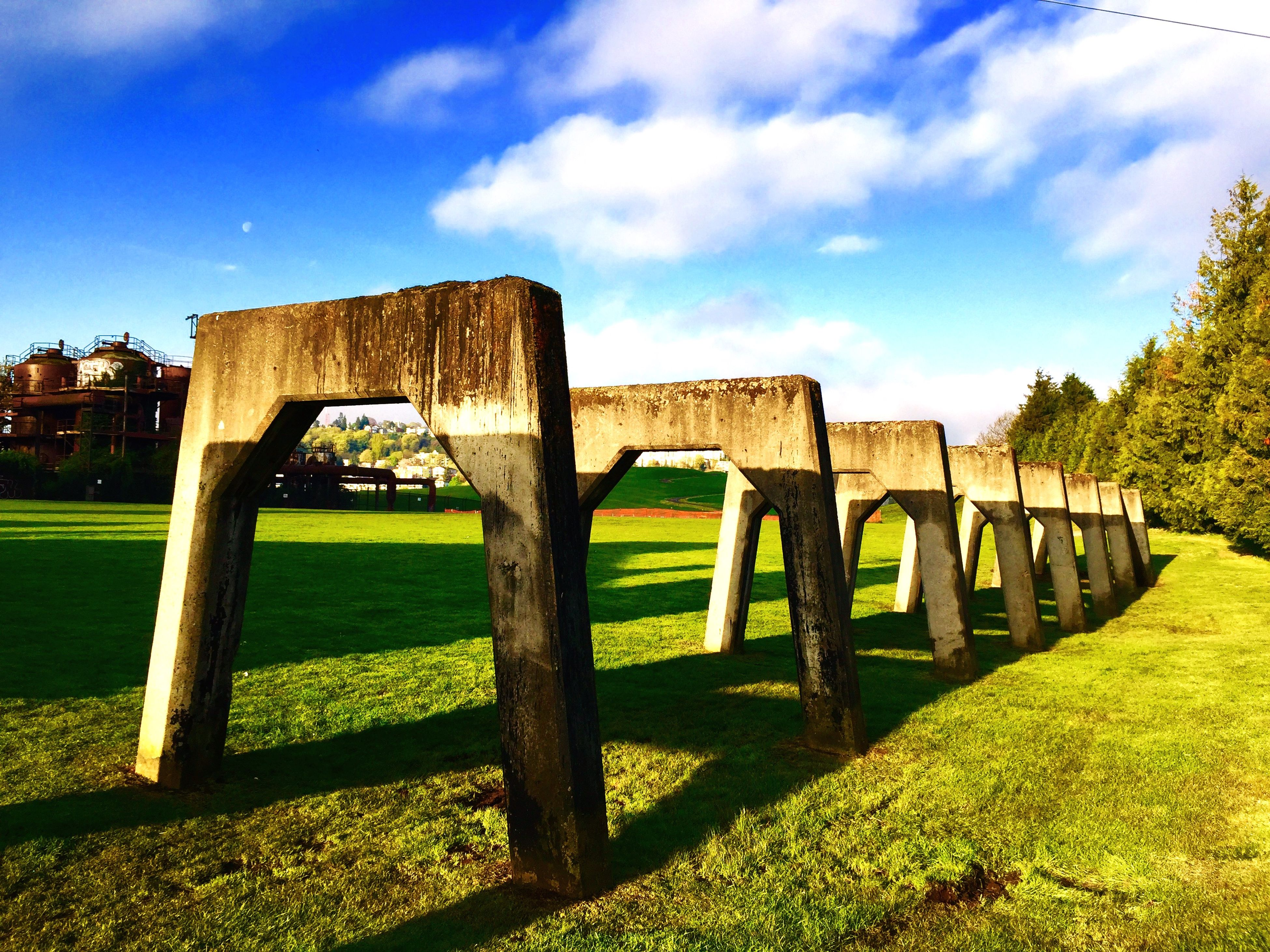 grass, sky, built structure, architecture, tranquility, cloud - sky, cloud, field, tree, tranquil scene, nature, green color, wood - material, scenics, landscape, day, grassy, shadow, outdoors, sunlight