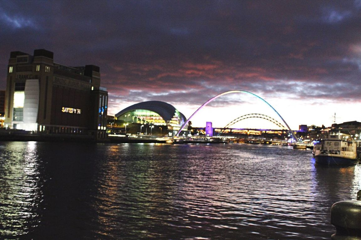 Newcastle Quayside Building Exterior Architecture Bridge Sky City Water Night Illuminated Cloud - Sky River Outdoors Waterfront Modern Cityscape Sunset No People Citylights Lights Rainbowlights Newcastle Upon Tyne