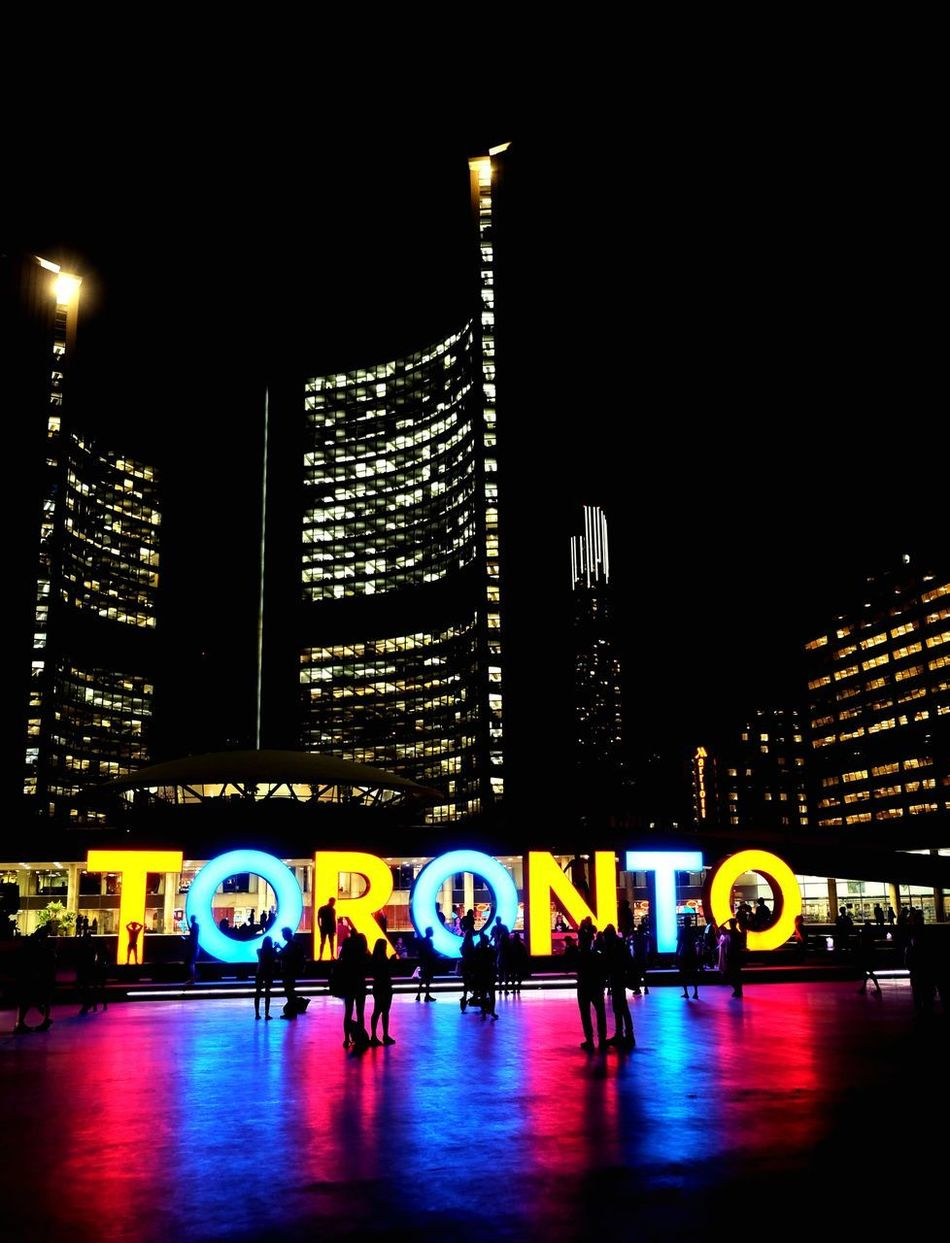 City as a stage Illuminated Architecture Night City Building Exterior Built Structure Travel Destinations City Life Neon Lights Neon Sign Signboard Signage City Life Cityscape Urban Geometry Urban Skyline Toronto Landscape Toronto Urban Landscape Outdoors Welcome To Black Skyscraper People Sky