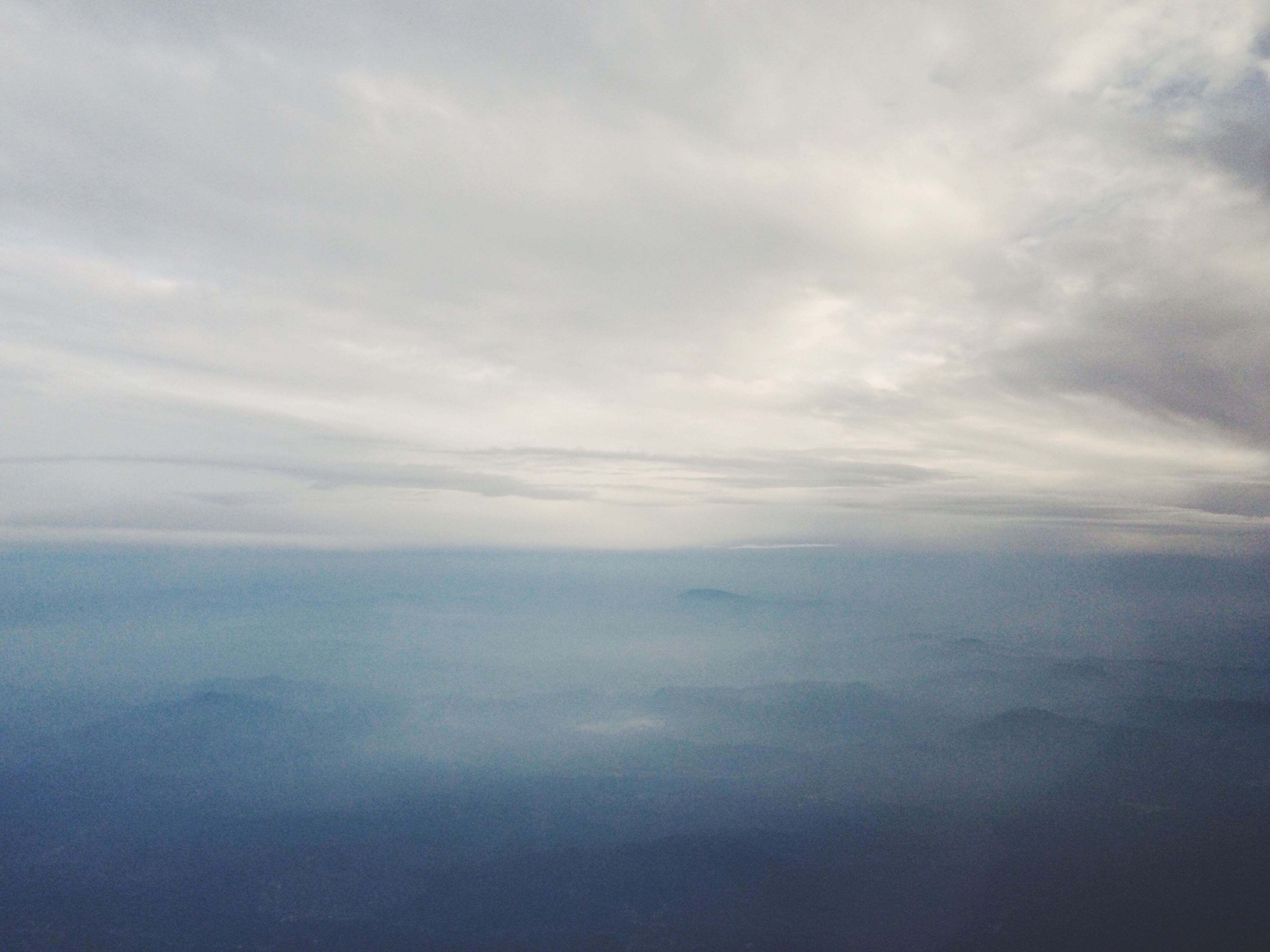 scenics, tranquil scene, tranquility, beauty in nature, sky, cloud - sky, nature, cloudy, aerial view, idyllic, cloudscape, weather, sea, cloud, day, no people, outdoors, landscape, water, waterfront