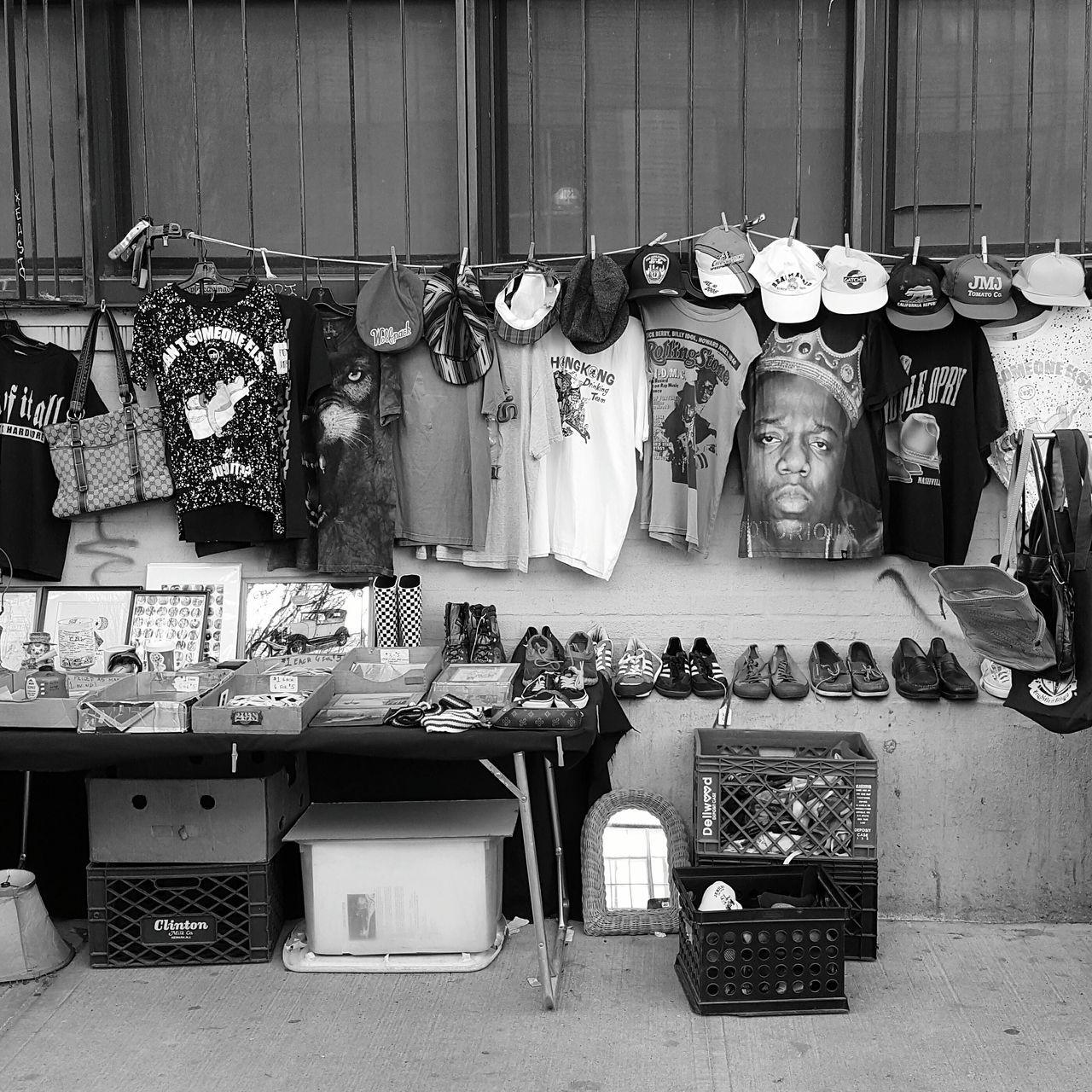 Sidewalk sale. NYC Photography EyeEmBestPics Streetphotography NYC Street Photography Streetartistry EyeEyem Mobile Photography Shootermag_usa Eeyem Photography Black & White Bnw_captures Bnw_friday_eyeemchallenge Urban Lifestyle No People Fashion Nostalgia NYC