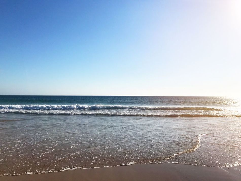 Sea Horizon Over Water Beach Water Scenics Nature Wave Clear Sky Beauty In Nature Tranquility Tranquil Scene Copy Space No People Sunlight Sand Day Sky Outdoors Blue