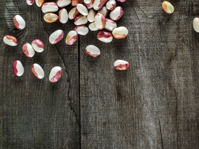Kidney beans on wood table background. Protein nutrition. Beans Day Full Frame High Angle View Kidney Limb No People Nutrition Order Petal Pink Color Protein Red Surface Level Table Wood Wooden