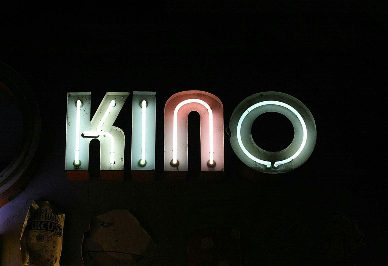 Night Text Communication Neon Black Background No People Nightlife Outdoors Kino Cinema Sign Signage Signporn Neon Sign Neon Color Vintage Lenses Light Illuminated Design Font