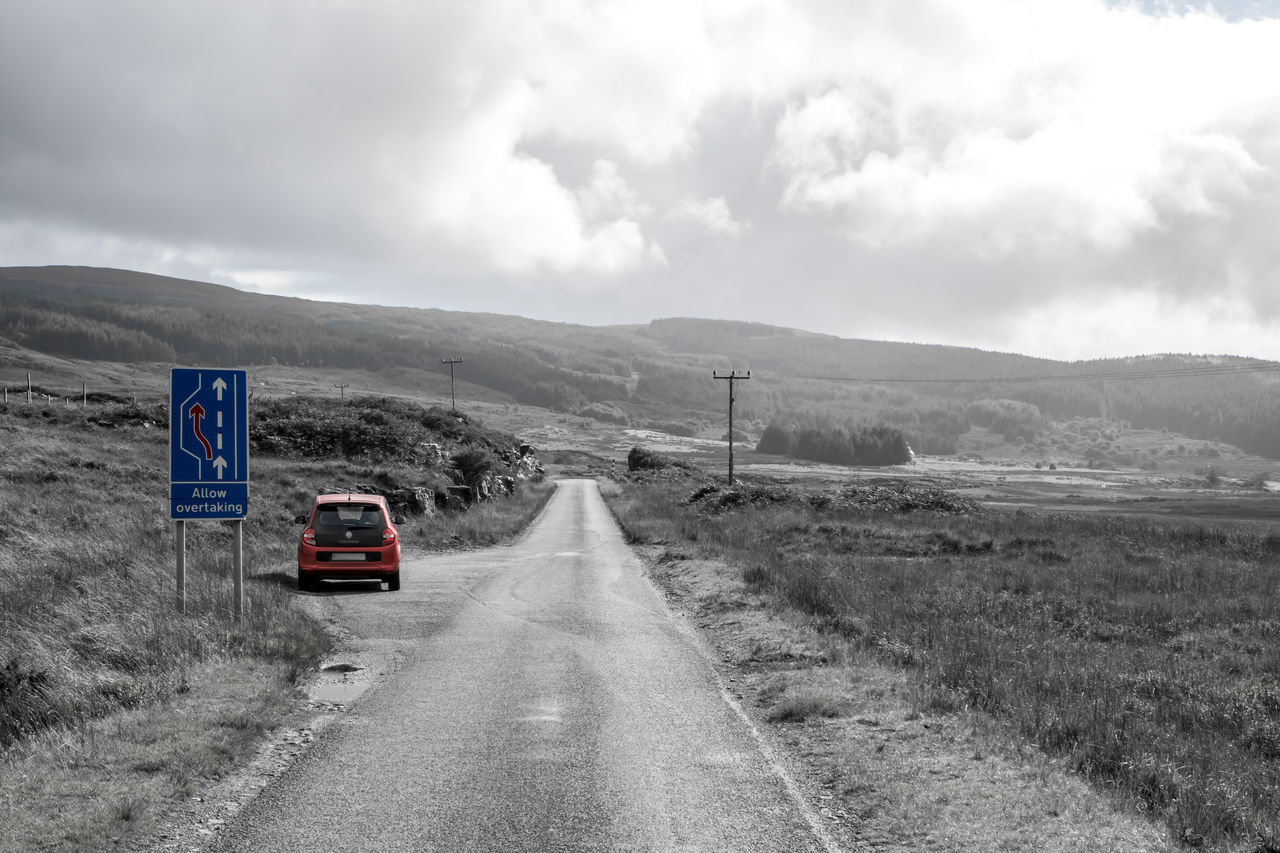 Isle of Mull, Scotland - Passing Place on deserted road, black and white with colored accents Black & White Blackandwhite Blackandwhite Photography Car Cloud - Sky Land Vehicle Mode Of Transport Monochrome Mountain On The Road Outdoor Photography Outdoors Passing By Road Scotland Sky The Way Forward Transportation Travel Traveling