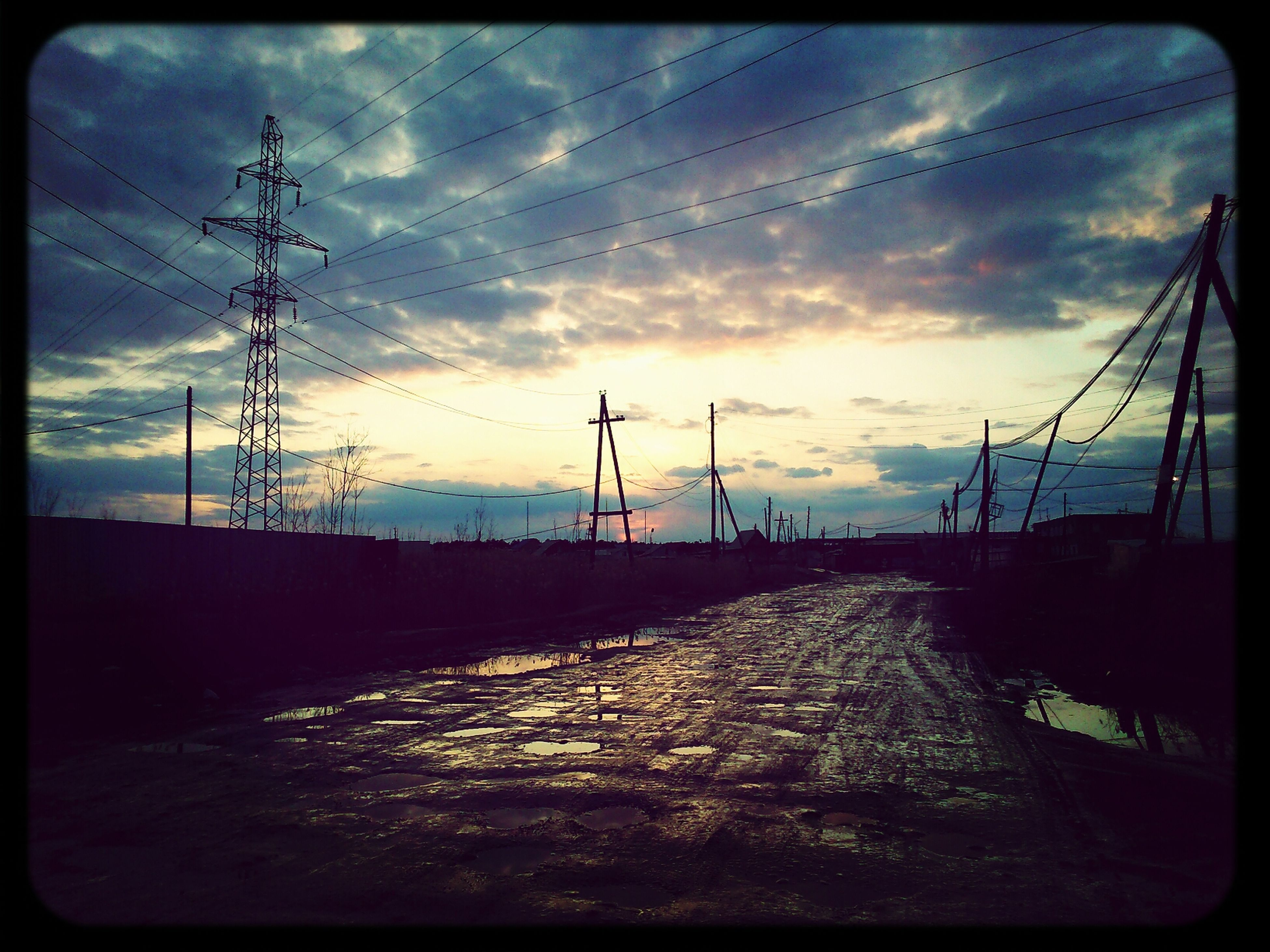sunset, sky, transfer print, electricity pylon, cloud - sky, power line, auto post production filter, cloud, silhouette, power supply, cloudy, the way forward, electricity, fuel and power generation, dramatic sky, road, dusk, orange color, connection, outdoors