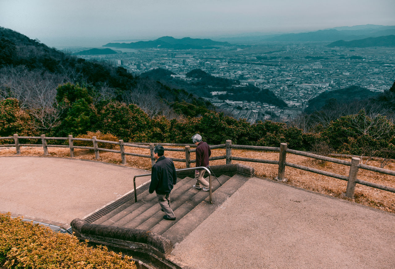// summing up japan // Beauty In Nature Day Full Length Japan Landscape Lifestyles Men Mountain Mountain Range Nature Outdoors People Railing Real People Rear View Scenics Sky The Great Outdoors - 2017 EyeEm Awards The Photojournalist - 2017 EyeEm Awards The Street Photographer - 2017 EyeEm Awards Togetherness Tree Two People Women Young Adult