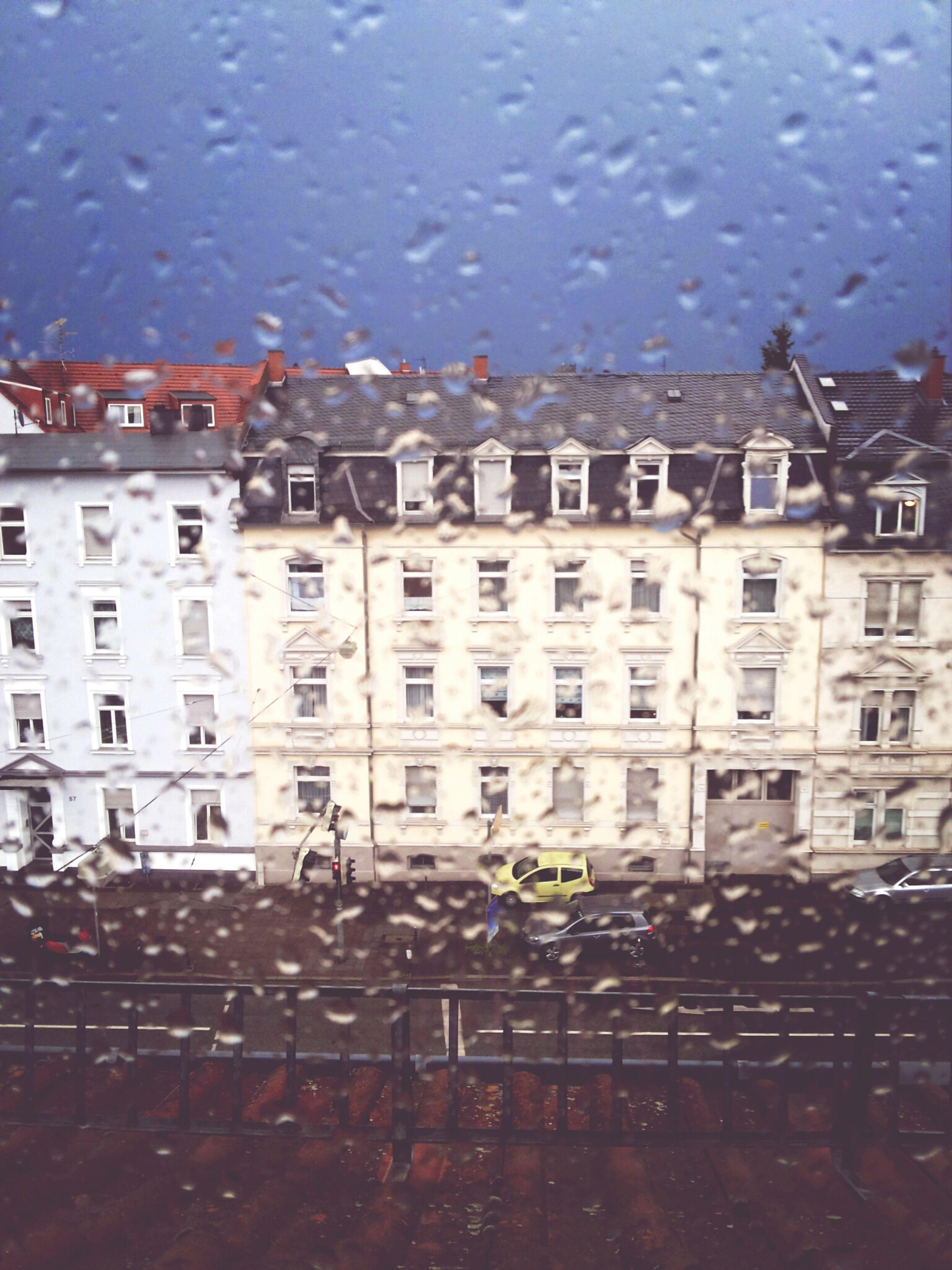 window, building exterior, architecture, built structure, glass - material, wet, sky, transparent, water, rain, drop, city, building, indoors, weather, glass, residential building, dusk, residential structure, season