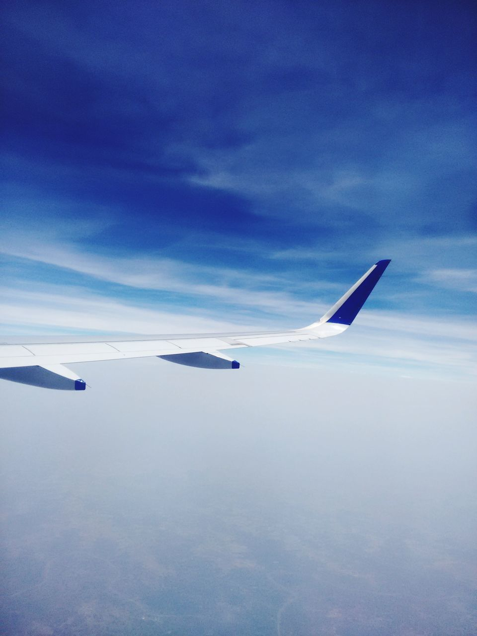 airplane, transportation, flying, sky, air vehicle, airplane wing, mode of transport, cloud - sky, blue, mid-air, aerial view, no people, journey, nature, travel, day, aircraft wing, outdoors, beauty in nature, scenics, sea, water
