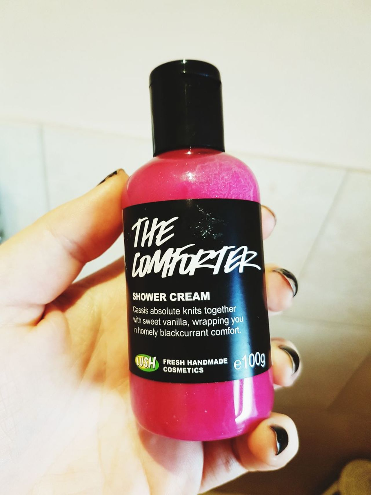 Human Hand Bottle Holding Label Indoors  Close-up Text Lush Lush Cosmetics The Comforter Shower Shower Gel