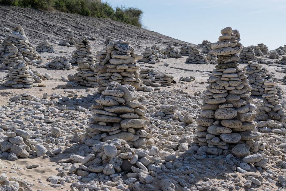 Cairns sur la plage Beach Cairn Cairns Day Ile De Ré Outdoors Pebble Pebbles On A Beach Pile Pile Of Pebbles Seashore Stack Stack Stacked