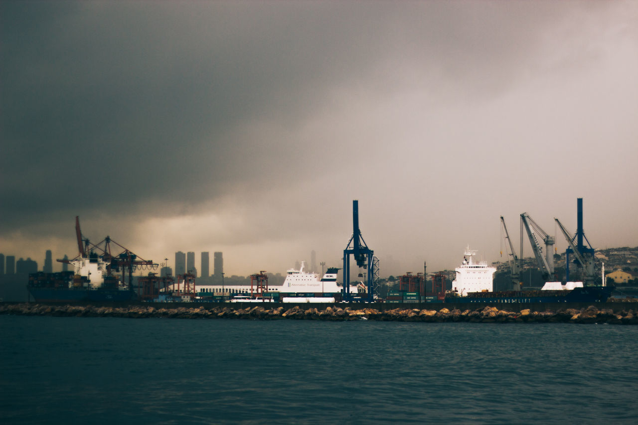 Architecture Built Structure City Cloud Cloud - Sky Cloudy Commercial Dock Container Ship Crane - Construction Machinery Day Development Dock Docks Harbor No People Outdoors Overcast Rain Scenics Ship Sky Tranquility Water Waterfront Enjoy The New Normal