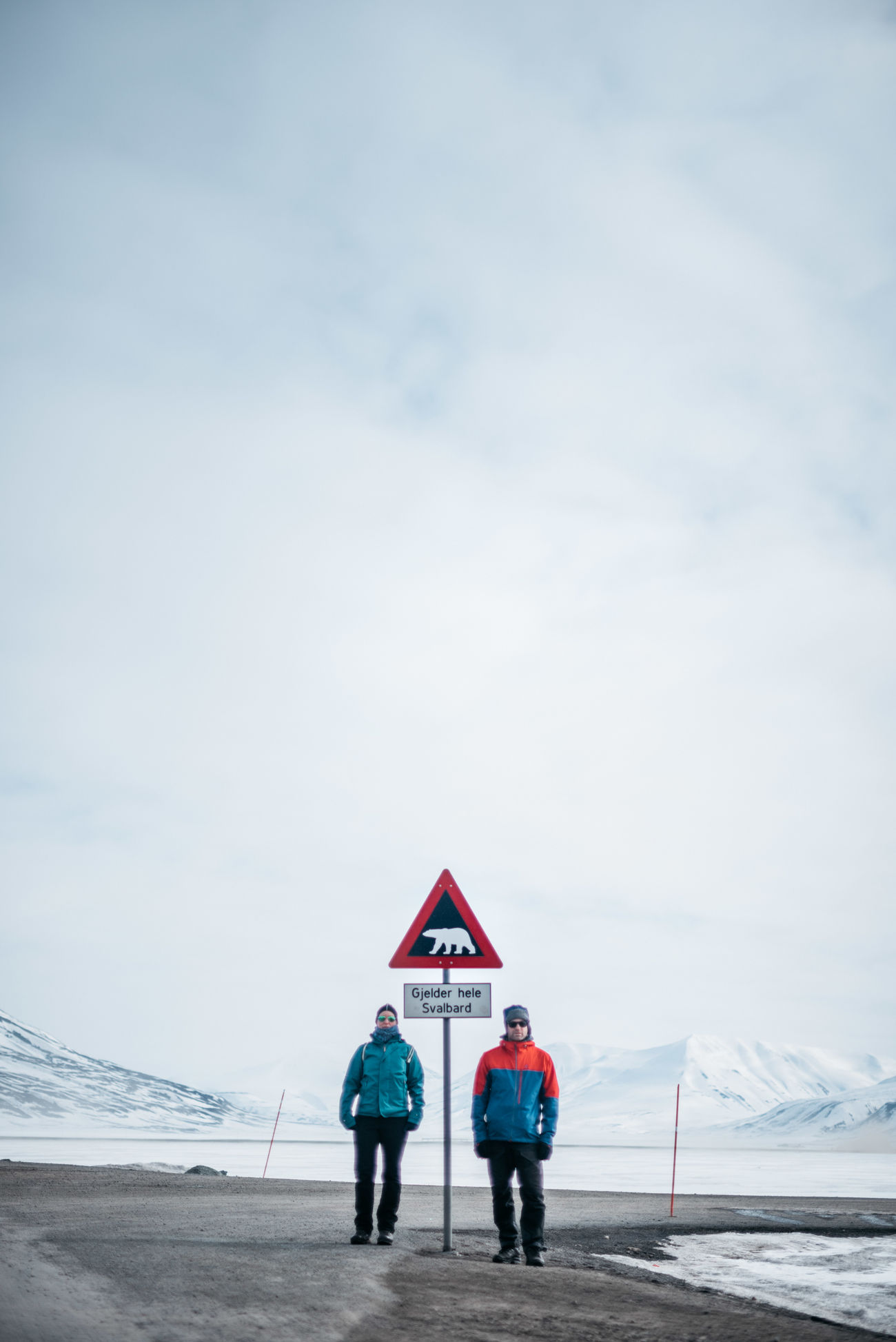 we are adventurer. we do thing we don't feel comfortable with. and we enjoy living. Adult Adults Only Cloud - Sky Danger Danger Zone Day Full Length Landscape Leisure Activity Lifestyles Nature Outdoors People Polar Bear Real People Sign Sky Standing Svalbard  The Great Outdoors - 2017 EyeEm Awards Two People Warning Warning Sign Weather Winter
