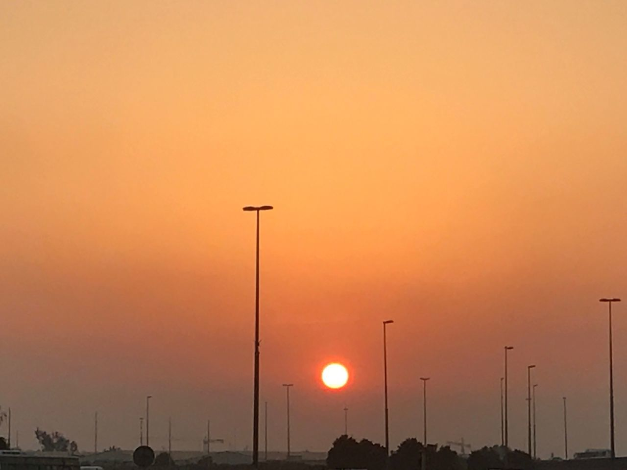sunset, street light, silhouette, orange color, transportation, outdoors, car, no people, sky, nature, sun, illuminated, beauty in nature, day