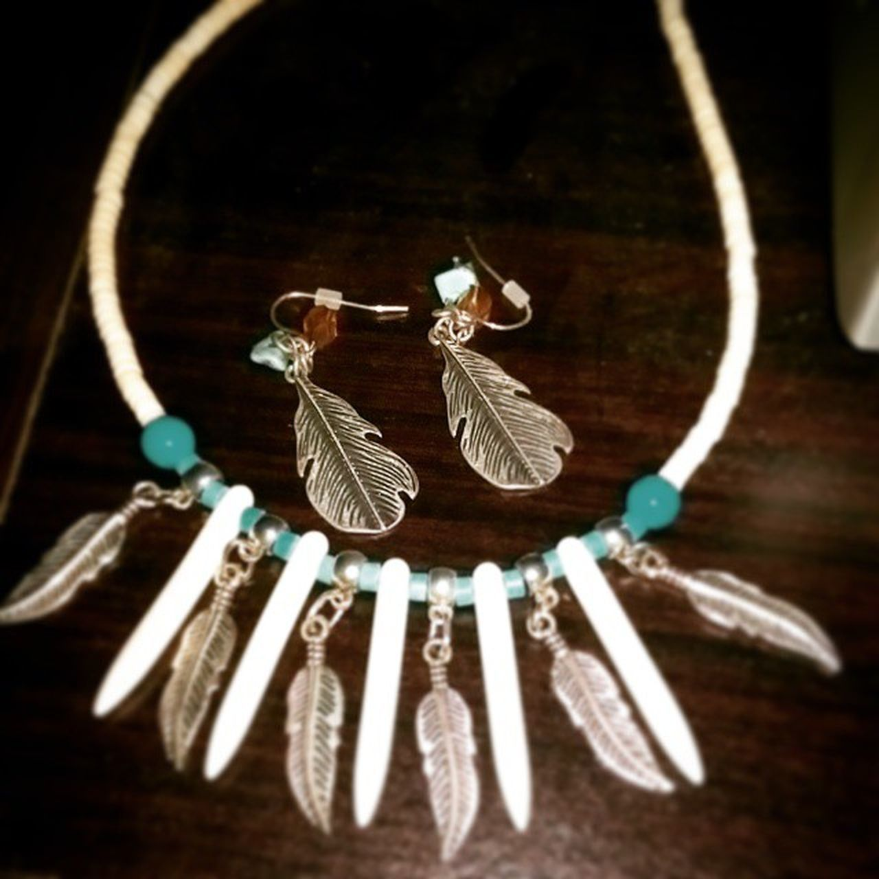 NYE jewellery lookin cute where I left them after I took them off last night. NYE Feathers Turquoise Necklace Earrings