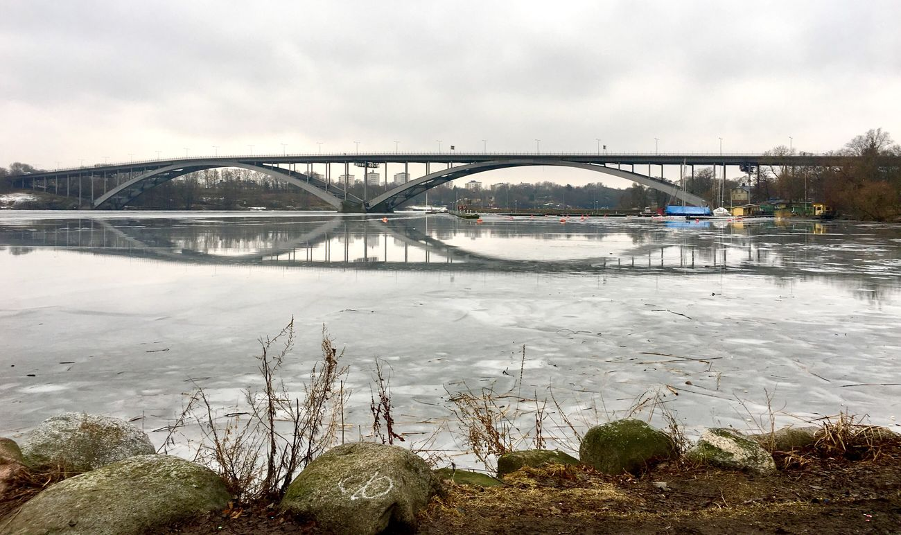 Water Architecture Built Structure Sky Weather Building Exterior Outdoors River City Day Bridge - Man Made Structure Nature No People Cloud - Sky Connection Winter Sweden Ice Lake Bridge Reflection
