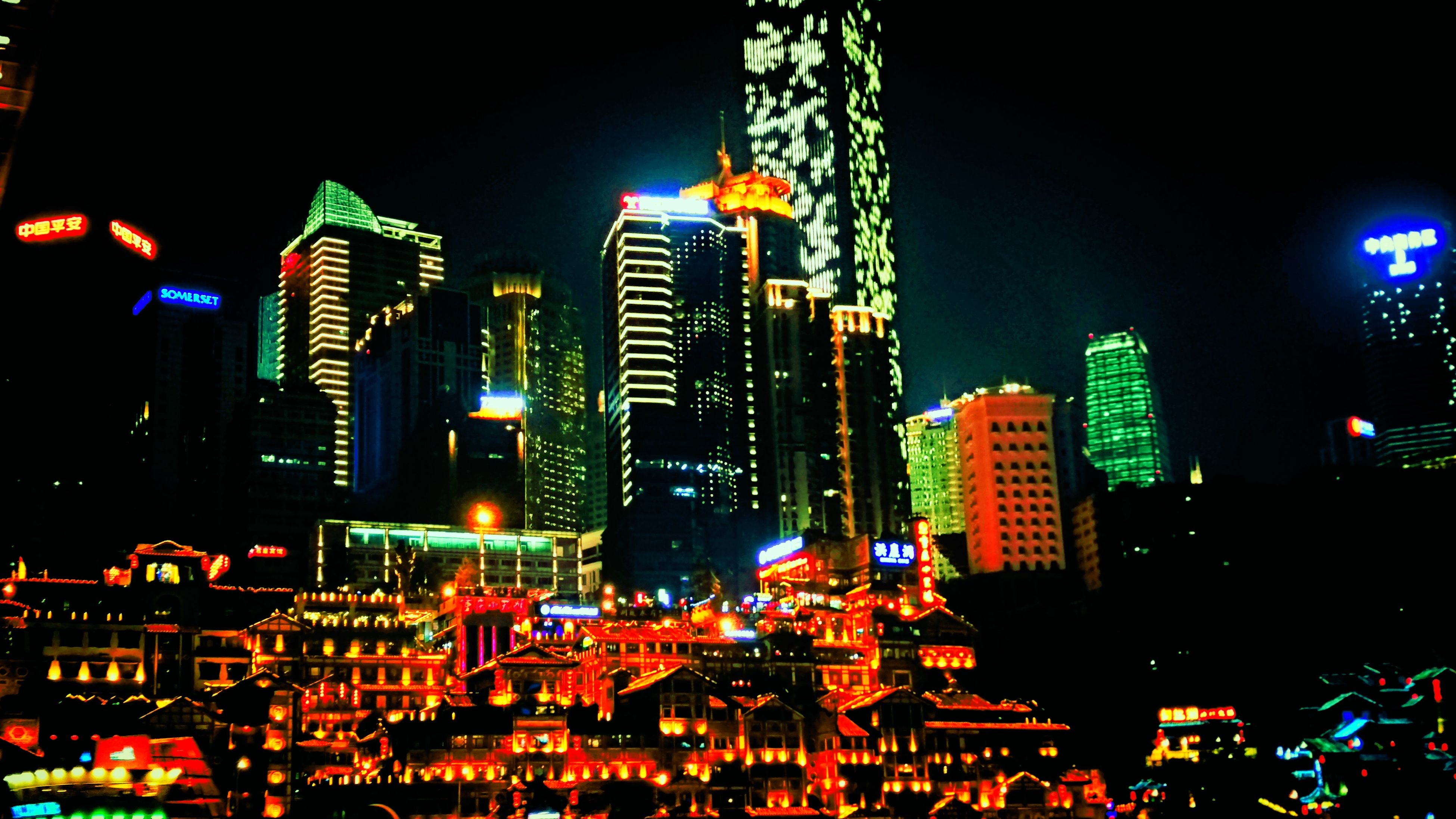city, illuminated, skyscraper, night, building exterior, architecture, city life, travel destinations, nightlife, urban skyline, city street, multi colored, outdoors, cityscape, built structure, sky, no people, motion, modern, downtown district, neon
