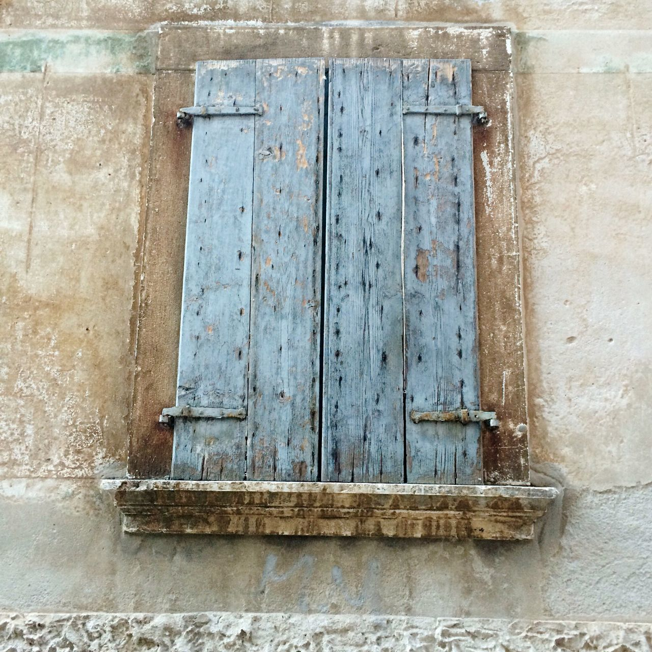 door, closed, old, no people, architecture, weathered, protection, hinge, built structure, wood - material, day, outdoors, building exterior, close-up, latch