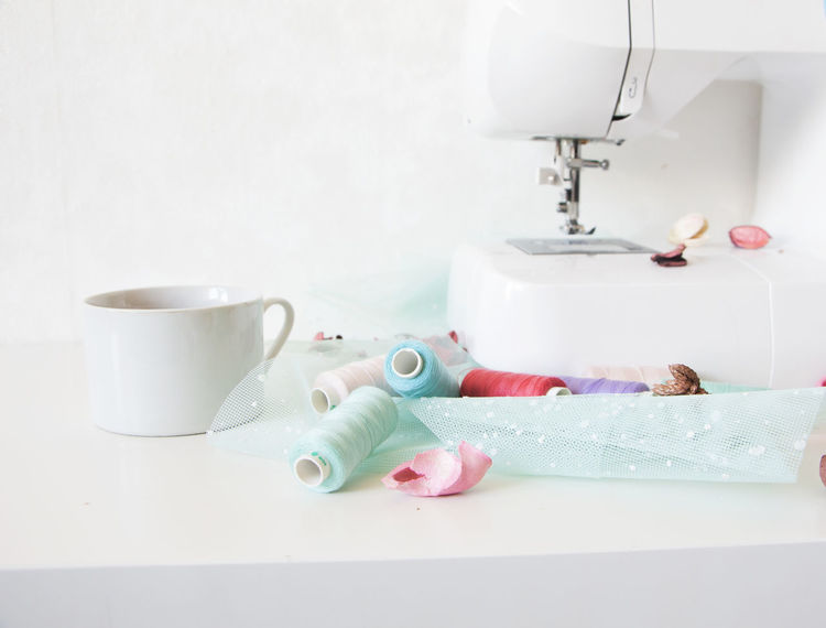 All White Colurful Thread Composition Creative Works Creativity Cup Fashion Hobbies Home Interior Indoors  Material Sewing Sewing Machine Table Thread White White Background White Cup White Table