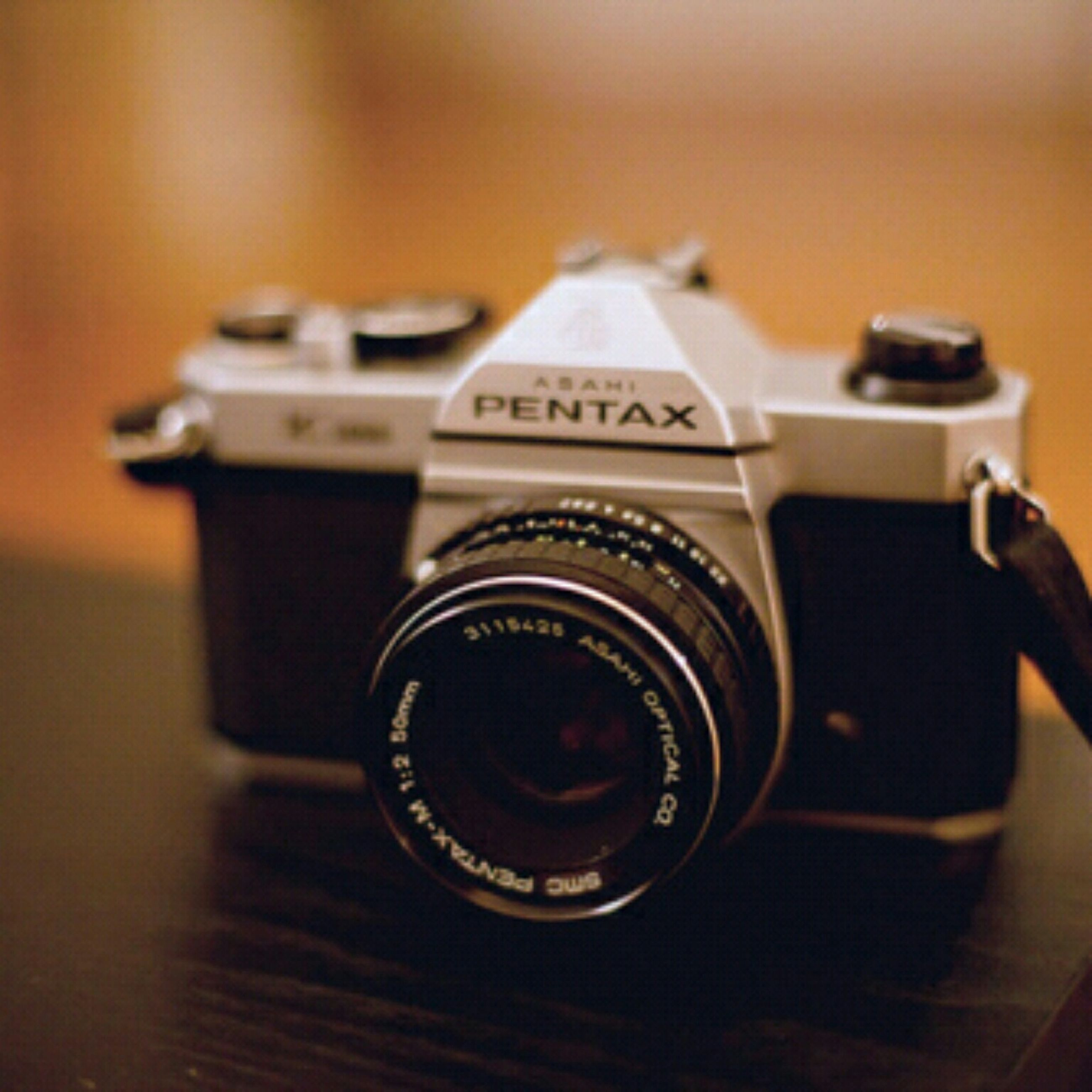 indoors, close-up, communication, technology, focus on foreground, photography themes, camera - photographic equipment, selective focus, single object, still life, text, table, old-fashioned, retro styled, western script, number, metal, music, lens - optical instrument, antique
