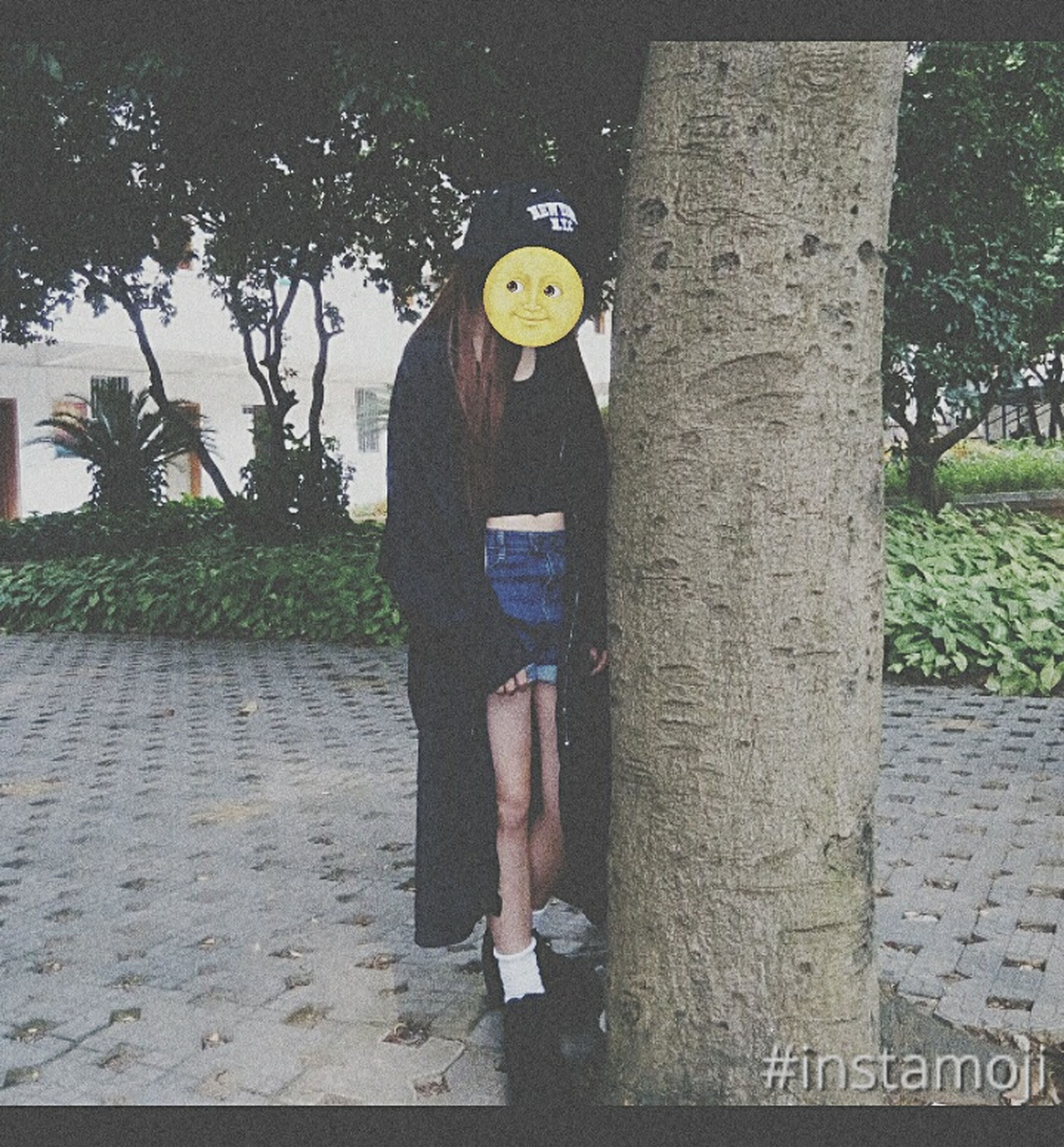 full length, tree, text, lifestyles, communication, leisure activity, casual clothing, day, outdoors, standing, human representation, front view, street, western script, protection, childhood, safety, number