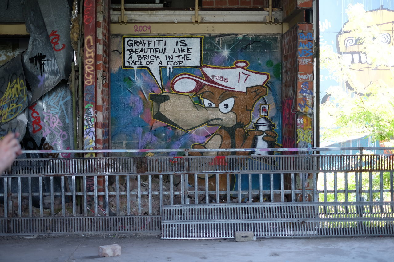 graffiti, text, art and craft, day, no people, architecture, built structure, skeleton, animal themes, indoors, mammal, close-up
