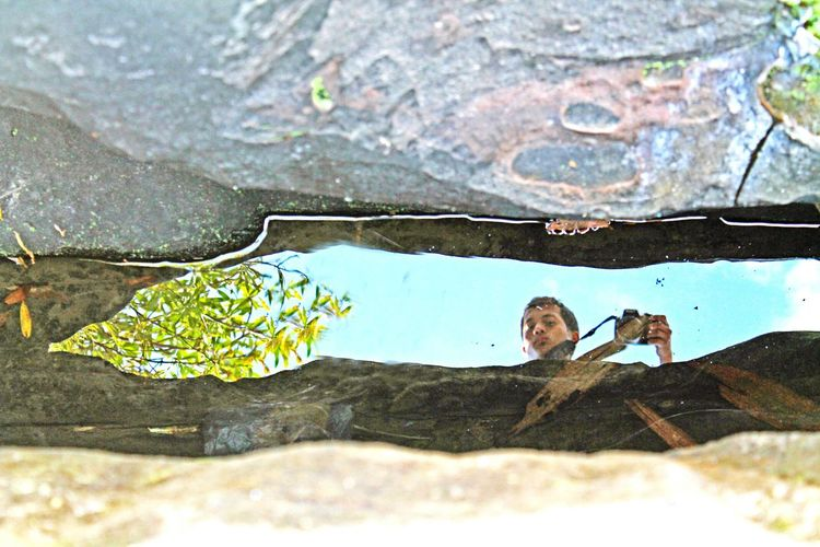 Me, My Camera And I Reflection a reflection of my camera and I in a stagnant water between the rocks..on the top of a dried up waterfall at Lawbah Waterreflections  Waterbetweentherocks