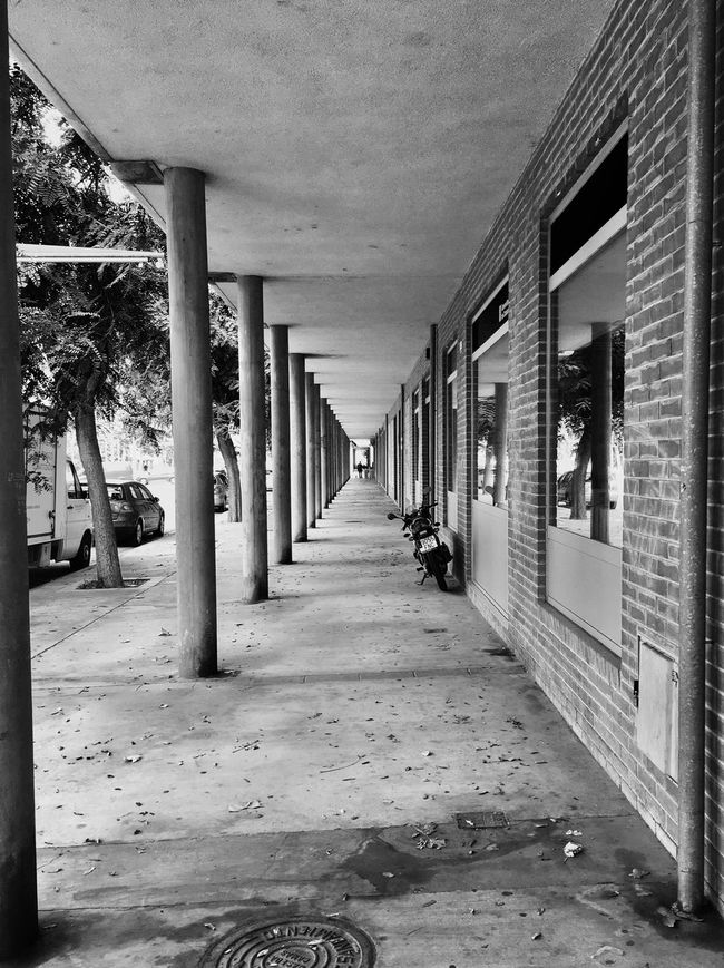 Turn the lights out now, now I take you by the hand, hand you another drink, drink it if you can. Can you spend a little time? Time sleeping away. Away from all, so stay. Stay with me, I can make, make you glad you came. Architectural Column The Way Forward Outdoors Built Structure Tunel Blackandwhite Streetphotography Street Photography