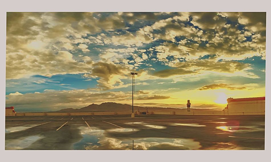 """""""Reflections on a Parking Garage"""" Wheneber it rains, thus is one of my favorite places to go. The uppermost deck floods a few inches and then products he most outstanding reflections of the sky and mountains around the Vegas Valley. Urban Geometry Cloud And Sky Light And Shadow Colors Of Autumn Eye4photography  IPhoneography EyeEmBestPics Mobilephotography"""