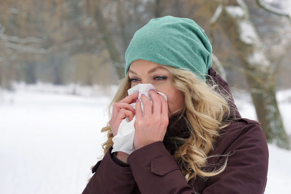 Blonde Blowing Chill Cold Flu Holding Nose Outdoors Paper Tissue Park People Person Real People Sneezing Snow Tissue Weather Winter Wiping Woman