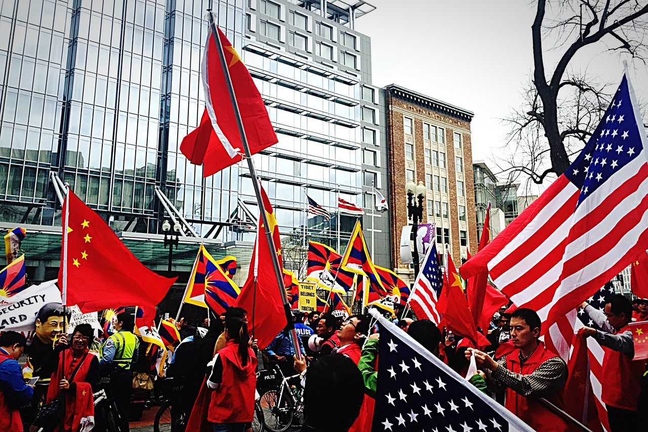 flag, patriotism, red, architecture, large group of people, pride, built structure, building exterior, protestor, men, crowd, day, outdoors, real people, city, sky, people, adult