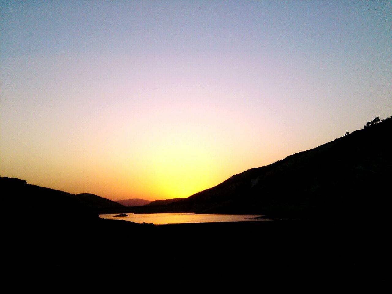 sunset, silhouette, nature, scenics, tranquil scene, beauty in nature, mountain, tranquility, no people, outdoors, sky, clear sky, landscape, mountain range, day