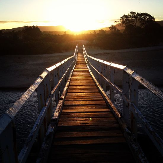 Beauty In Nature Bridge - Man Made Structure Day Footbridge Jetty Lake Nature No People Outdoors Pier Railing Scenics Sky Sunlight Sunset The Way Forward Tranquil Scene Tranquility Tree Water Wood - Material Wood Paneling